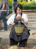 A woman showing the craft of basket-making Stock Photography