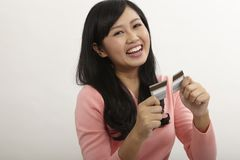 Woman showing credit being destroy. Asian woman happy stop using credit card stock photo