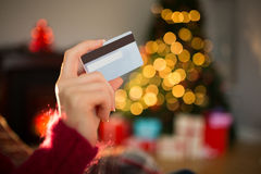 Woman showing credit card at christmas Stock Photos