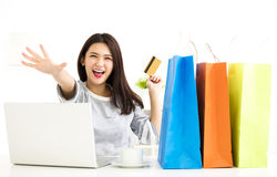 Woman showing credit card And Shopping Online Stock Photo