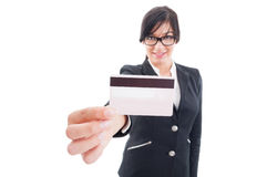 Woman showing credit card to the camera Royalty Free Stock Images