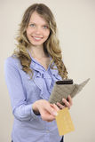 Woman showing credit or gift card Stock Images