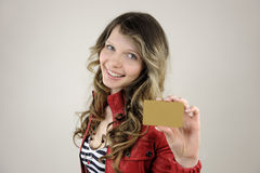 Woman showing credit or gift card Stock Photos