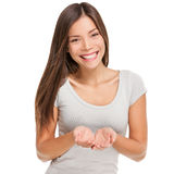 Woman showing cupped hands holding something Stock Photography