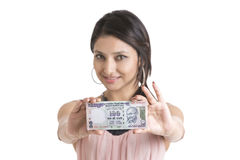 Woman showing currency notes Royalty Free Stock Image