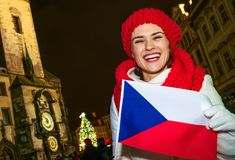 Woman showing Czech flag on Staromestske namesti in Prague Stock Photography