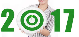 Woman showing dartboard with number 2017. Image of woman showing a green dartboard with numbers 2017. Isolated on white background Stock Photography