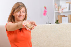 Woman showing deaf aids. On her hands stock image
