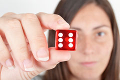 Woman showing dice Royalty Free Stock Image