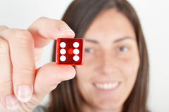 Woman showing dice Stock Photo