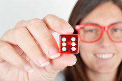 Woman showing dice Stock Photography