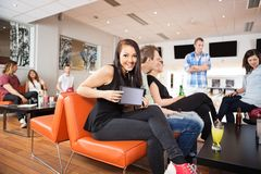 Woman Showing Digital Tablet in Bowling Alley Stock Images
