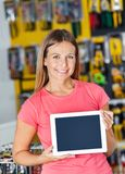 Woman Showing Digital Tablet In Hardware Store Royalty Free Stock Images