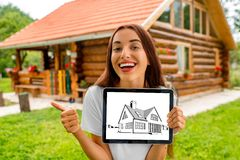 Woman showing digital tablet with house drawing Royalty Free Stock Photo