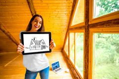 Woman showing digital tablet in the wooden house Stock Photo