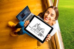 Woman showing digital tablet in the wooden house Royalty Free Stock Image