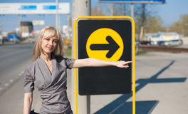 Woman showing a direction Stock Photo