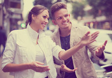 Woman Showing Direction To Guy Royalty Free Stock Photo