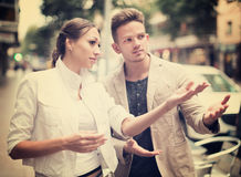 Woman showing direction to guy Royalty Free Stock Images