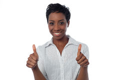 Woman showing double thumbs up. Keep up the awesome work team, great job Royalty Free Stock Image