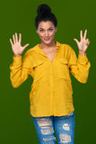 Woman showing eight fingers Royalty Free Stock Photo