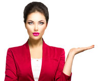 Woman showing empty copyspace on the open hand palm. Business woman showing empty copyspace on the open hand palm royalty free stock photography