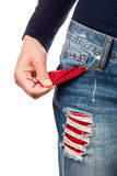 Woman showing empty pocket. Royalty Free Stock Photography