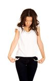 Woman showing empty pockets. Royalty Free Stock Photos