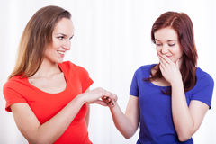 Woman showing engagement ring to her friend Royalty Free Stock Images