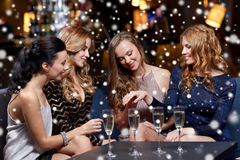 Woman showing engagement ring to her friends. Celebration, friends, bachelorette party and holidays concept - happy women showing engagement ring to her friends Stock Photos