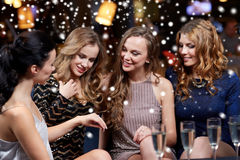 Woman showing engagement ring to her friends. Christmas, friends, bachelorette party and winter holidays concept - happy women showing engagement ring to her Royalty Free Stock Images