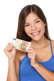Woman showing euro money. 50 bill. Multicultural girl smiling happy and fresh isolated on white background Royalty Free Stock Photo