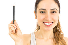Woman showing eyebrow pencil Royalty Free Stock Photos