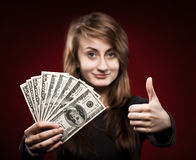 Woman showing fan of money Royalty Free Stock Image