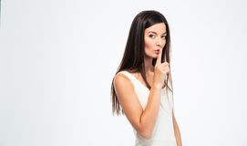 Woman showing finger over lips Stock Photos