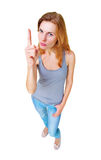 Woman showing finger up sign full length standing isolated Stock Photo