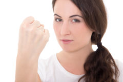 Woman showing fist of rage isolated on white background. Young woman showing fist of rage isolated on white background Stock Image