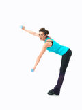 Woman showing fitness routine, white background. Sexy, young woman showing fitness moves, on white background Stock Images