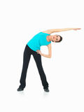 Woman showing fitness routine, white background Stock Photos