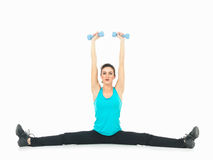 Woman showing fitness routine, white background Royalty Free Stock Photography