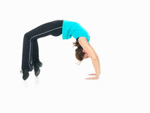 Woman showing fitness routine, white background. Sexy, young woman showing fitness moves, on white background Royalty Free Stock Images