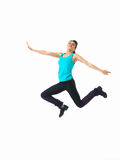 Woman showing fitness routine, white background. Sexy, young woman showing fitness jump, on white background Stock Image