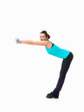 Woman showing fitness routine, white background. Sexy, young woman showing fitness moves, on white background Stock Image
