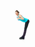 Woman showing fitness routine, white background. Sexy, young woman showing fitness moves, on white background Royalty Free Stock Image