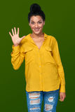 Woman showing five fingers Royalty Free Stock Images