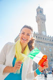 Woman showing flag in front of palazzo vecchio Royalty Free Stock Image