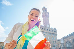 Woman showing flag in front of palazzo vecchio Stock Photos