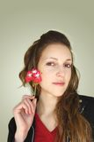 Woman showing a flower Royalty Free Stock Images