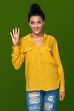 Woman showing four fingers Stock Photography