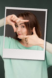 Woman showing  frame with fingers Royalty Free Stock Images